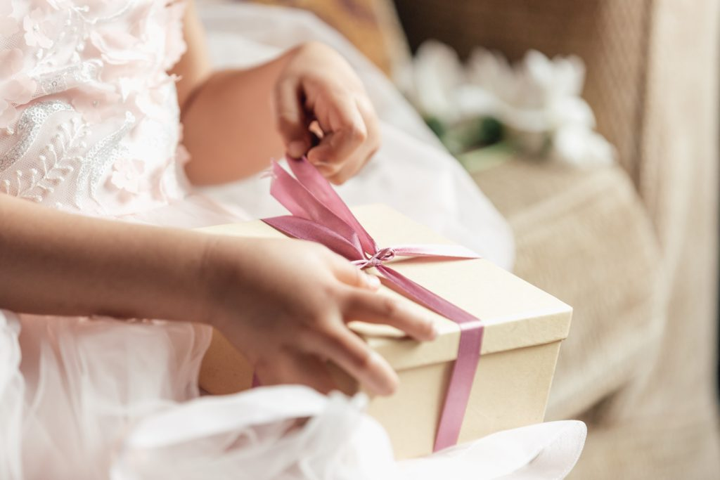 young-girl-opening-gift_4460x4460